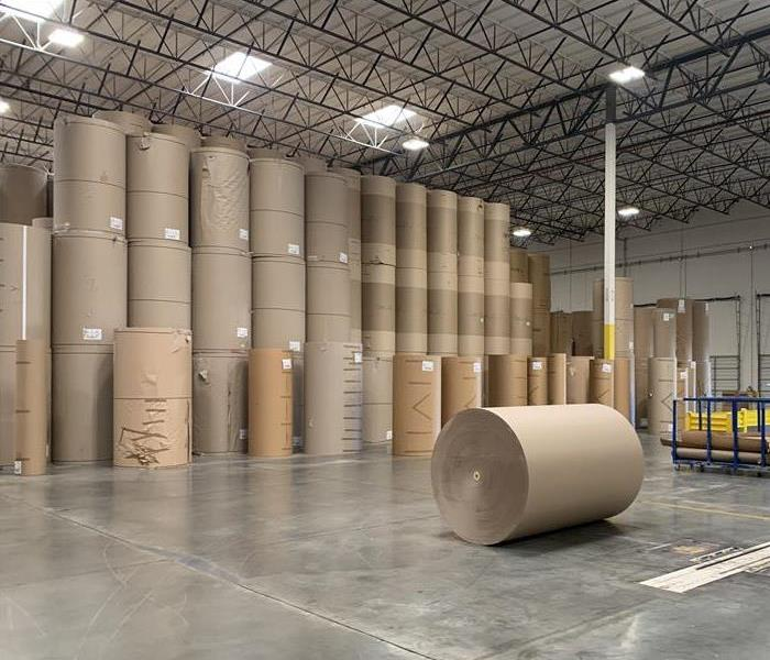 warehouse with large paper rolls on a clean floor