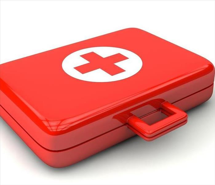 Red safety kit with a white and red emergency symbol
