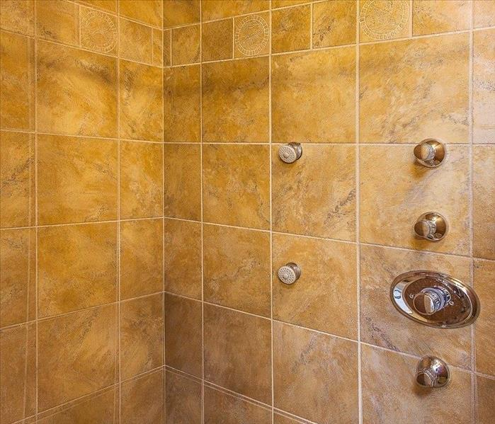shower with golden tiles