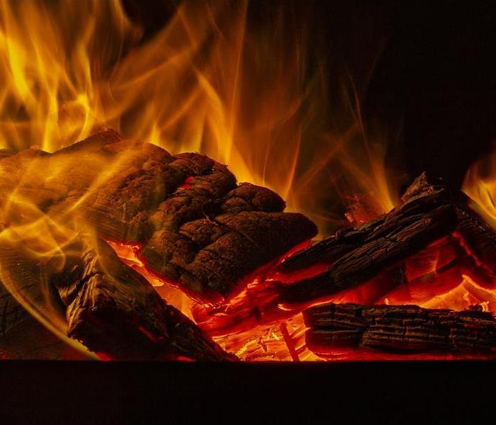 Burning wood with black background