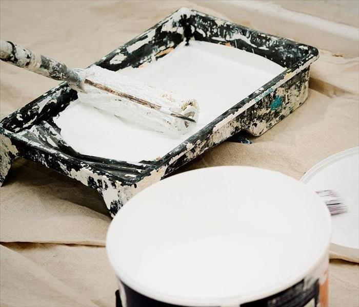 white paint and paint supplies