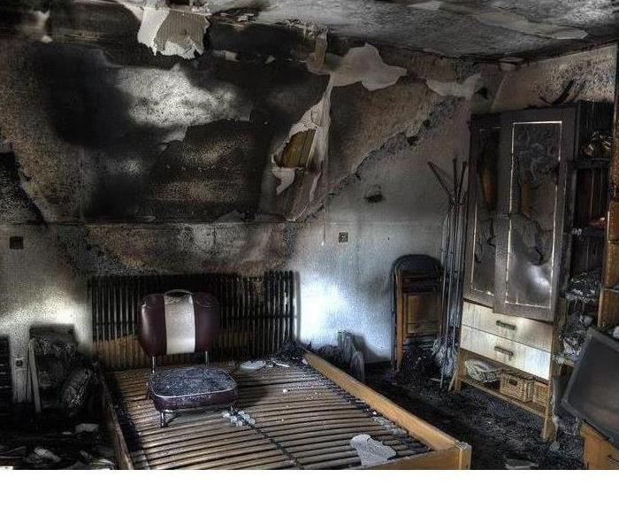 Bedroom with fire damage